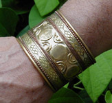 Brass cuff bracelet with copper inlay measures 2 inches wide.