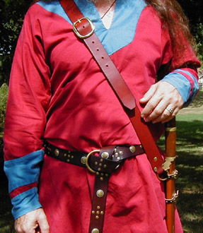 Our Versatile Baldric in Chestnut Leather shown from the front with sword hanging vertically.