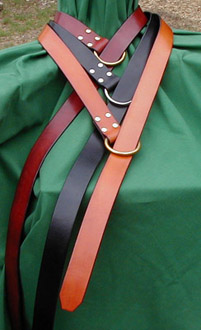 A basic element of any Medieval or Renaissance costume, our ring belts are crafted of fine bridle leather. Shown here in chestnut, black and dark tan.