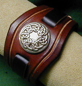 Glasgow Leather Bracelet shown in Chestnut Leather with Pictish Knot Nickel Silver Adornment
