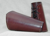 Simple Bracers shown in rich dark brown bridle leather.
