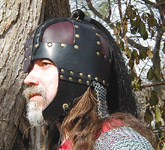 Side view of our leather Anglo-Saxon Helm. Shown in black with dark brown plates.