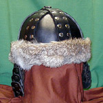 Our leather Mongol Helm shown in black with nickel rivets and natural rabbit fur trim.