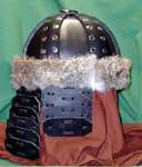 Our leather Mongol Helm shown in black with nickel rivets, lamellar cheekplates and aventail with natural rabbit fur trim.