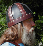 Our Six-Sided Leather Spangenhelm shown in Dark Brown and Black leather with brass rivets.
