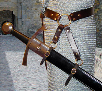 Our Sword Belt of the Circle is based on an example in a late Medieval painting. Shown side view in dark brown leather with brass hardware.
