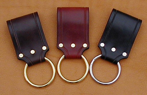 Our Ring Frog fits belts up to 2-1/2 inches wide. Shown here in dark brown, chestnut, and black leather. Your choice of nickel or brass ring.